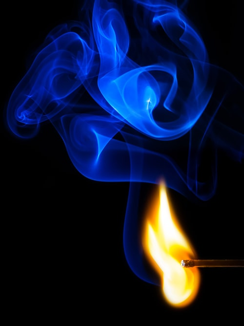 a match with blue fire to reinforce the key message of the site - my mentoring will help you light a fire under your business