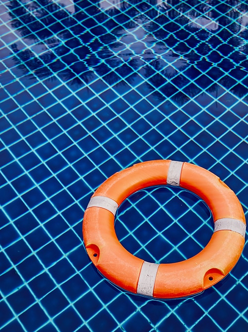 a life ring in a swimming pool reinforces the statements that business owners may relate to